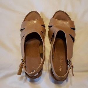 Adorable tan sling back sandals